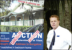 SIGN OF TIMES: Real estate agent Mark Kinneally is upset by the Cancelled signs placed over his house auction sign in Bangalo