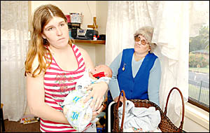 PUSHED OUT: Tara Randall holds baby Bailey at her Casino home. Taras mother, Michelle Webber, is staying with her daughter for