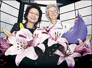 THING OF BEAUTY: Flower designer Yoko Kirikoshi, from Japan, admires the ikebana display by Patricia Wilson, of the Lismore Cha