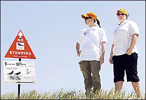 Pied oystercatcher wardens Brooke Larance (left) and% Rebecca Scott on beach patrol.