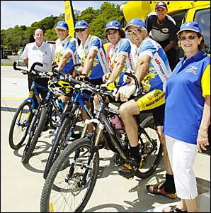 SADDLING-UP: Bike ride fundraisers (from left) John Eggins of Prestige Homes, Alan Job, Geoff Pilgrim, Tony Keogh, tour directo