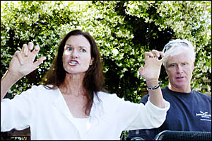 Linda Whitehurst, pictured at Byron Shire Hospital yesterday with her husband Glen, indicates how she fended off the great whit