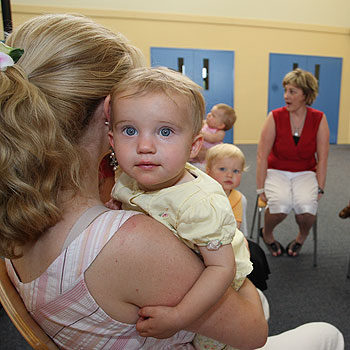 Psychologist Lisa Lindley talks with mums at the PND suport group. Photo: Nicholas Falconer/169766
