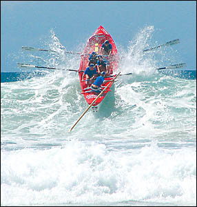 A file picture of a Evans Head crew battling the surf in competition.