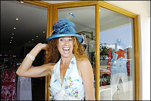 FROCKING UP: Janine Russell, pictured trying on hats in Lennox Head yesterday, has been preparing for the Ballina Cup since Mar