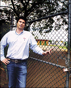 Damon Rahmate, senior sales consultant at Elders Bangalow, in front of the sewerage facility which holds the key to a new Banga