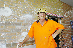 MINDLESS: Carpenter Shane Livingston inspects the damage caused by vandals at this Lennox Head construction site. Picture: DAVI
