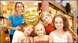 REAL-LIFE HERO: Meeting Shrek at Ballina Fair last Saturday are (rear) Katrina Warren from centre management, Nic Warren, of Le