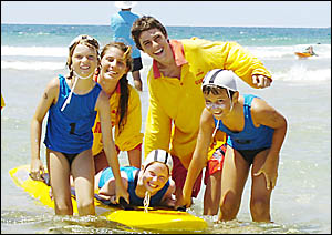 NIPPERS (from left) Gus Dennis, Azlan Currie and Nat Russell, all 9, of Brunswick Heads, and lifesavers Tom Preston and Emily B
