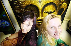 SMUDGING MAKES ME FEEL GOOD: Ghost smudger Amanda Taber (left), of Angel Blessing, helped Bay Kaz-Bah co-owner%Karen Lindsay