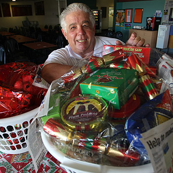Queensland Hoteliers Association Sunshine Coast divisional president Kevin Asmus with the Adopt-A-Family Christmas hampers. Photo: Michaela O'Neill/71076a