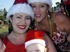 Kobi and Debbra Nygrin, with four-month-old Jed Young, get into the Christmas spirit at last weekend's Pelican Waters Christmas Carols last night. Photo: John McCutcheon/171013e