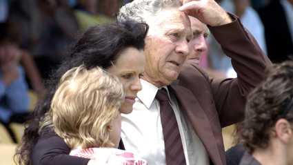 Tearful Debbie Baker (centre) farewells her son, jockey Daniel Baker, who died after a race fall last week.