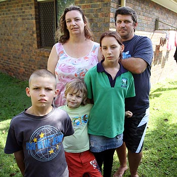 Dionne and David Hirst with children Zayden, 5, Tristan, 7, and Ayeisha, 11, are struggling to find suitable accommodation on the Coast, despite applying for more than 40 properties.  Photo: Michaela O'Neill/mo171086