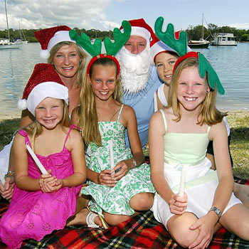 Tanya and Mathew with children Lauren, Taylor, Emma and Faith, get ready for carols on the river.