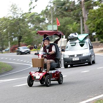 An elderly man causes traffic mayhem on Buderim-Mooloolaba road as traffic swerves to avoid his motorised scooter. Photo: Chris McCormack