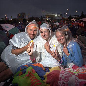 Darren Rowsell, Amy Kent and Jordan Falconer at the Christmas carols at Kings Beach. Photo: Cade Mooney