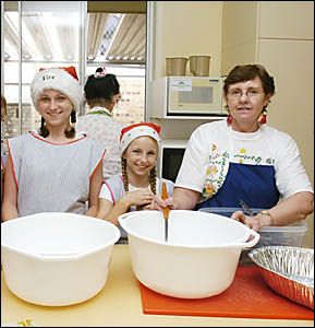 READY TO HELP: Volunteers at the Lismore Soup Kitchen, Montanna (12) and Maddeline Hannigan (10), of Lismore, and Wendy Lane, o