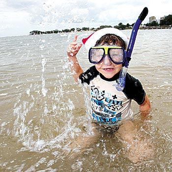 Seven-year-old Tye King from Palmwoods celebrates Christmas at Cotton Tree with his family. Photo: Cade Mooney
