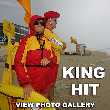 Volunteer lifesavers Cecily Messer and Tony Eiby keep an eye on the few brave people who ventured into the water at Maroochydore Beach yesterday. Photo: Brett Wortman/bw171337j