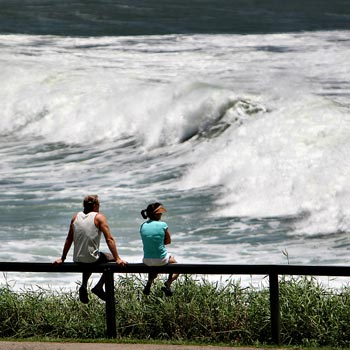 Spectators gathered on Alexandra Headland to watch the wild seas as surfers took advantage of the swell. Photo: Michaela O'Neill/171402