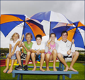 RACES THE BEST BET: Keeping dry at the Ballina New Year race meeting yesterday are (from%left) Shauna, 8, and Sam Renwick, 11,