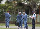 Crime scene investigation officers look at the house in conection with the death of a 10-year-old girl on Bribie Island. Photo by Michelle Fleming