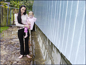 CLOSE CALL: Donna Teeling of Ocean Shores next to her backyard drain where daughter Zoe fell in during yesterdays flooding