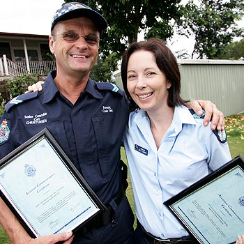 Senior Constable Carl Christensen and Sergeant Kelly Harvey with their bravery awards.
