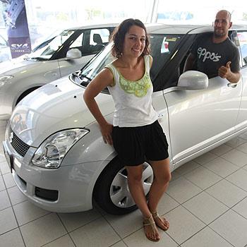 Katie Gannon and Brent Fannin with their new Suzuki Swift. Photo: Michaela O'Neill/172035c