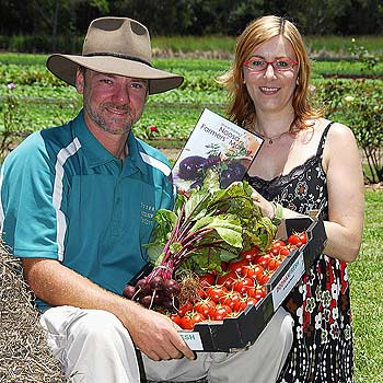 Noosa Farmers Market founder Shane Stanley and author Petra Frieser with Petra's book about the markets. Photo: Geoff Potter