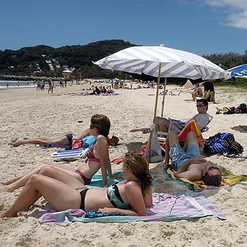 Noosa Beach is a haven for sunbathers, but most of the young people making the most of yesterday's rays had taken heed of the slip, slop, slap warning. Photo: John McCutcheon/N19486a