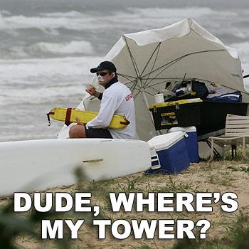Hyatt Coolum lifeguard John Dobell has a flimsy umbrella that protects a wheelbarrow holding his rescue gear as his tower. Photo: Chris McCormack.