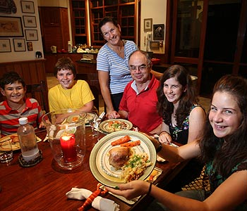 The Costa family – from left are Richard, family friend Stuart Rees, Linda, Carlos, Kim and Steph – sit down for dinner every night. Photo: Cade Mooney/cm172060a