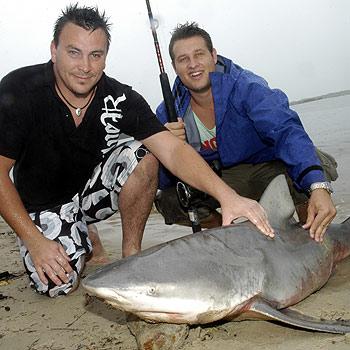 Luke Jones (left) and Nathaniel Marker caught this 82kg bull shark in a Noosa canal. Photo: John McCutcheon/N19517d