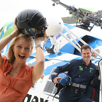 Amber Werchon of Ray White Real Estate and Energex helicopter pilot Brent Hall gear up for the race day at Corbould Park.  Photo: Chris McCormack/cm172092