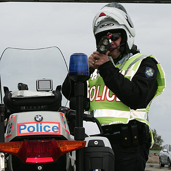 Traffic policeman Dave Nelson is on the road to catch speeding drivers. Photo: Barry Leddicoat/172100