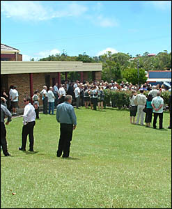 Mourners spill out of St Finbarrs Catholic Church in Byron Bay yesterday at the funeral of businessman Mark Wallace.