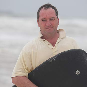 Queensland Nationals Senator Barnaby Joyce has put his surf skills to the test by rescuing a New Zealander at Marcoola on Monday. Photo: Jason Dougherty.
