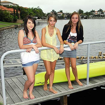 Louisa Gamble (centre) of Noosa Waters will not be swimming with friends Amy Woods (left) and Brittany Phillis in the canal  behind her home after her parents banned her after a shark was caught recently. Photo by Geoff Potter