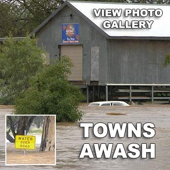 A car is submerged by the rising floodwaters at Charleville in western Queensland. Photo: The Western Times, Charleville.