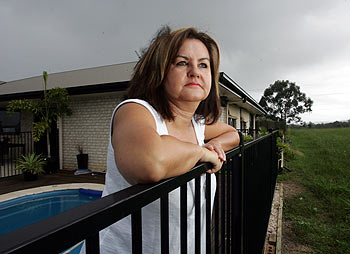 Maryanne McGregor looks over the now serene outlook from her back fence at Palmwoods, the land will be resumed for the relocation of the railway line to Brisbane. Photo: Chris McCormack