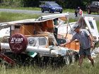 This caravan crumpled like cardboard when it rolled on the Bruce Highway near Elimbah. Photo: Michaela O'Neill/172225g
