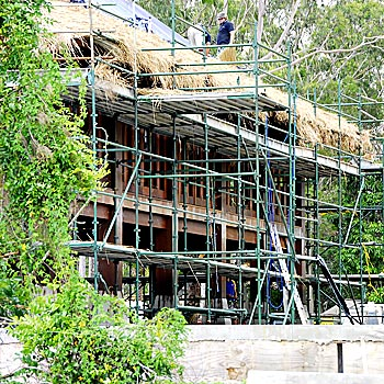 Work proceeds on Makepeace Island, owned by Richard Branson, in Noosa River.