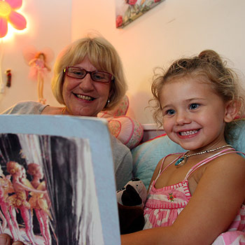Kay Mallett loves reading to her grandaughter Rani. Photo: Jason Dougherty/ 172153c