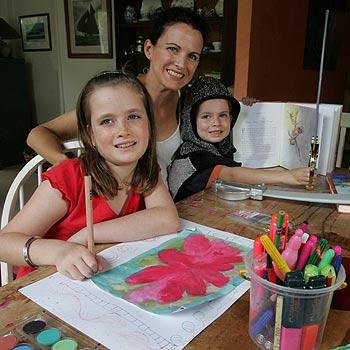 Bli Bli State School teacher Joanna Bateman makes the most of the final days of the holidays with children Phoebe, 8, and Charlie, 5. Photo: Brett Wortman/172193a