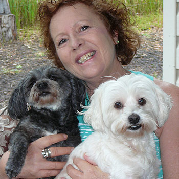 Pomona-based animal psychic Liza Callen with pooches Peace and Harmony.