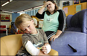 SAVAGED: Rodney Beveridge, 8, of Urbenville, with his mum Kristine, recovering in Lismore Base Hospital after being attacked by
