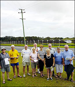 FLOODING FEARS: Concerned residents and staff of the Ballina Gardens Caravan Park (from left) Trev Bence, Dave Crockett, Reg Ho