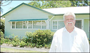 TOP LOCATION: Brunswick Heads real estate agent Russell Siwicki outside the two-bedroom cottage in Booyun Street, Brunswick Hea